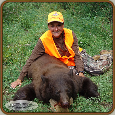 Rhonda with her first Bear, a gorgeous chocolate color phase Colorado Black Bear. Our Bear Hunts put you in the right place at the right time for maximum success.