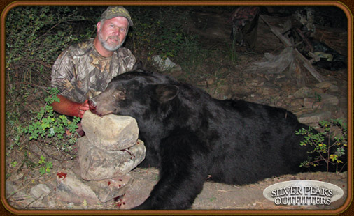 Wally with his Trophy Boone & Crockett class Bear taken with Silver Peaks Outfitters of Southwest Colorado.